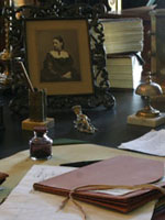 Photograph of books, documents and miscellaneous items on a desk in the office of Sir�John�A.�Macdonald in the East Block of Parliament, 2007